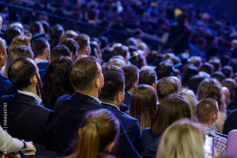 Fototapeta People attend business conference in the congress hall