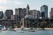 Yacht and sailing boats on Charles River in front of Boston Skyline in Massachusetts USA on a sunny summer day