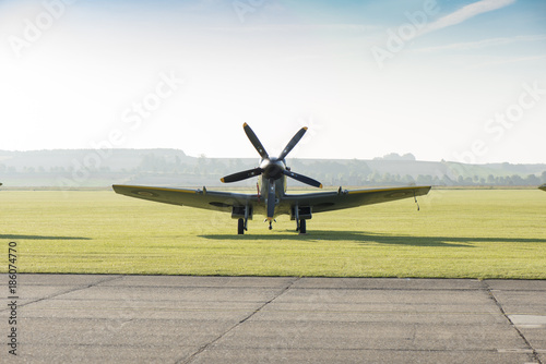 Canvas Print Front View of Classic Spitfire Aircraft by a Runway