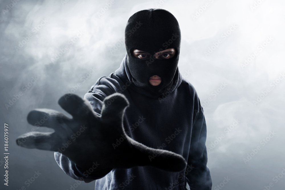 Fototapeta Thief in balaclava