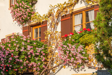 Traditional Bavarian House Decorated With Flowers
