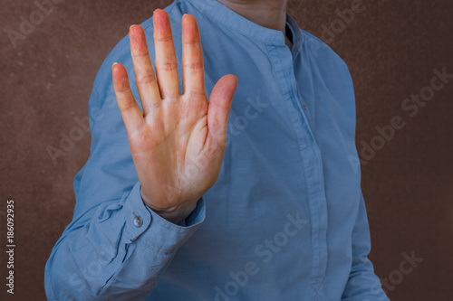 Fotografie, Obraz  Woman signals defensive attitude with hand