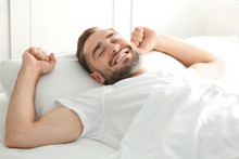 Morning Of Handsome Man Lying In Bed At Home