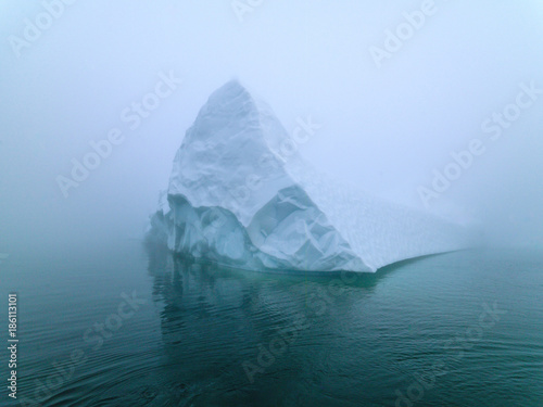 Poster Glaciers Icebergs in foggy day on Arctic Ocean in Greenland