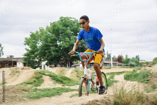 Fotografie, Obraz  Teen boy riding dirt bike on track course