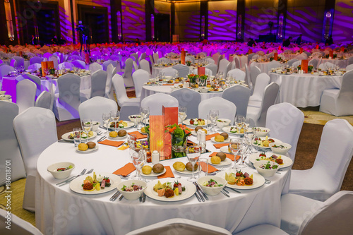 фотографія  Wedding hall or other function facility set for fine dining
