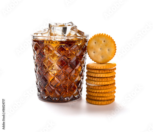 cup of iced cola and sandwich biscuits on white background Tablou Canvas