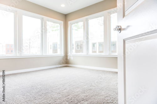 Empty bedroom entrance in new modern luxury apartment home with many large windo Canvas Print