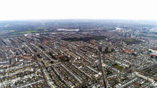Aerial View Of Chelsea, Fulham, West Kensington And Parsons Green In London Cityscape Skyline Drone Shot. Fulham Football Club Stadium Craven Cottage In Distance