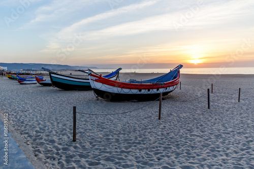 Tuinposter Koraalriffen fishing boat on the beach at sunset, Nazare, Portugal