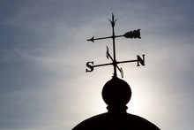 Weather Vane Against The Sun.