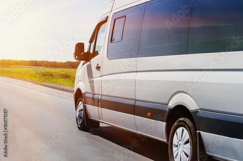 Fotografie, Obraz  minibus goes on the country highway