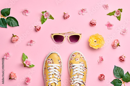 Fashion Woman Accessories Set. Pink Pastel Color. Flat lay. Minimal Style. Trendy fashion Sneakers, Glamour Summer Sunglasses. Roses Flowers, leaves. Spring Floral