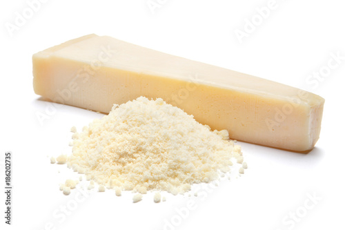a piece of Parmesan and grated cheese on white background Fototapeta