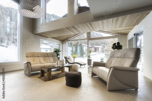 living room of luxury house with mountain view in modern design © Federico Rostagno