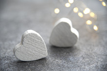 Two White Hearts On A Background Of Light Bulbs. Valentines Day