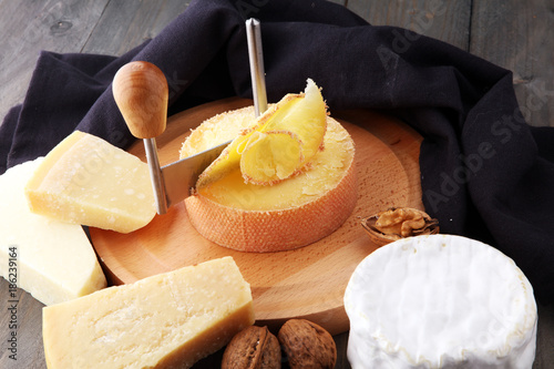 Special cheese knives. The girolle scraper in cheese wheel. Cheese shaving decoration.