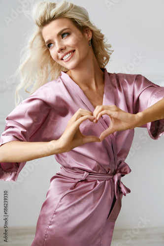Love. Beautiful Female Model Showing Heart With Hands. Fototapeta