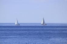 Two Sailboats On Open Sea Hori...