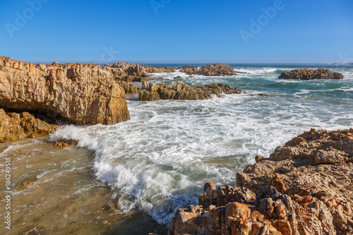 Tuinposter Kust Sea and Rocks at the Knysna Coast in South Africa