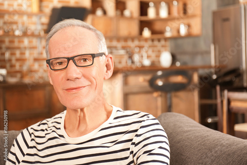 Fototapety, obrazy: Attractive mature man in casual clothes indoors