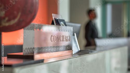 Fotografía Concierge service desk counter with hotel staff team working in front of recepti