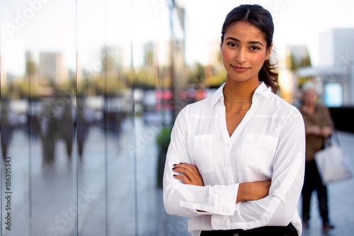 Fotografie, Obraz  Serious career motivated successful female business professional standing proud