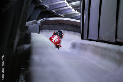 Foto op Aluminium Wintersporten bob sled speeding in an ice channel