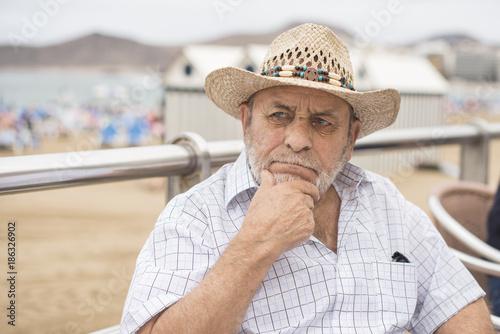 Portrait of a man wearing a straw hat