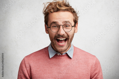 Portrait Of Happy Glad Young Bearded Male With Excited Cheerful