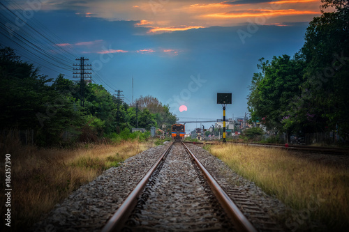 Valokuva  Vintage railroad and train in Railway Station in Thailand