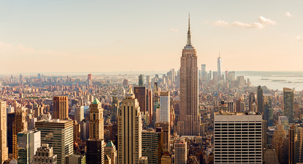 Fototapeta Nowy York Manhattan Midtown Skyline with illuminated skyscrapers at sunset. NYC, USA