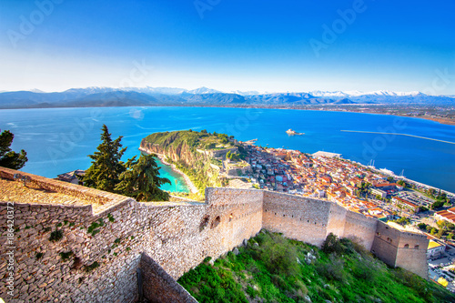 Fotografiet  Old town of Nafplion in Greece view from above with tiled roofs, small port and