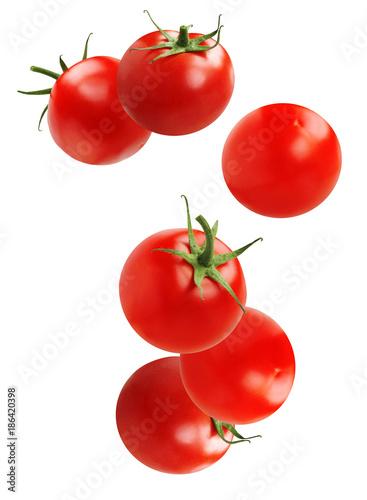 Falling tomato, isolated on white background.