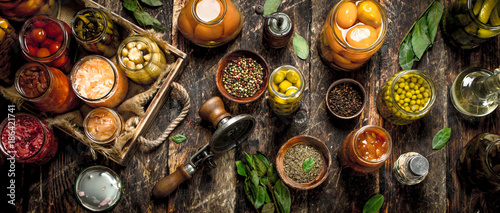 Various preserved vegetables and mushrooms with seamer and spices Canvas Print