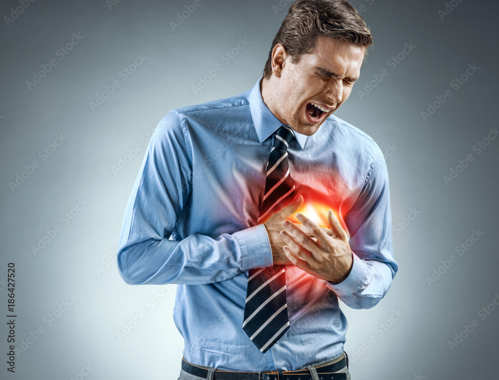 Fototapety, obrazy: Office manager holding hands on painful chest. Medical concept. Heart attack.
