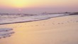 Tropical beautiful sunset in the sea ans splashing waves at the beach in slow motion. 1920x1080
