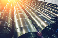 Stack Of Steel Or Metal Pipes Or Round Tubes As Industrial Background With Perspective And Sunshine Effect