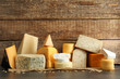 canvas print picture - Different kinds of delicious cheese on table