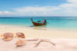 Summer vacation concept with accessories on sandy beach