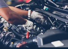 Hands Of Auto Mechanic Repairing Car. Selective Focus.