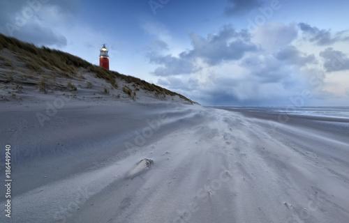 Fototapeten Leuchtturm lighthouse by North sea coast in dusk