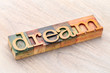 dream word abstract in wood type