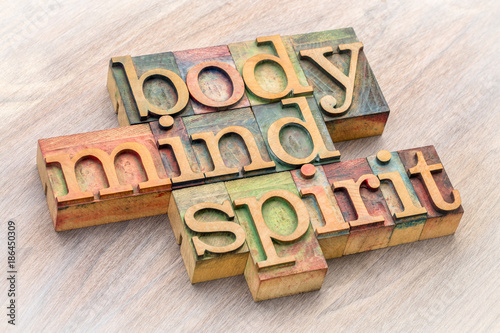 Fotografija  body, mind and spirit word abstract in wood type
