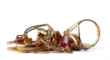 A Scrap Of Gold. Old And Broken Jewelry, Bullions Isolated On A White Background..
