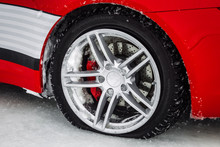 Close-up Car Wheel With Tire Flat And Air Leak From Accident. On The Winter  Road .