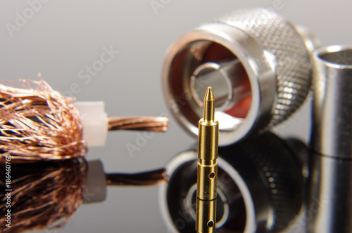 Pinturas sobre lienzo  Coaxial cable connector assembly accessories isolated on the black reflecting ba