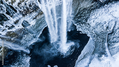 Poster Watervallen Aerial photo of the Seljalandsfoss waterfall in winter