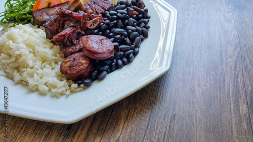 Fotografie, Tablou  Feijoada - Traditional Brazilian food