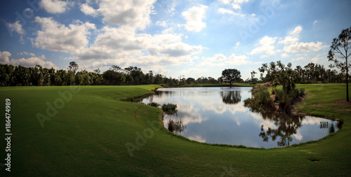 Fotografie, Obraz  Pond and Lush green grass on a golf course